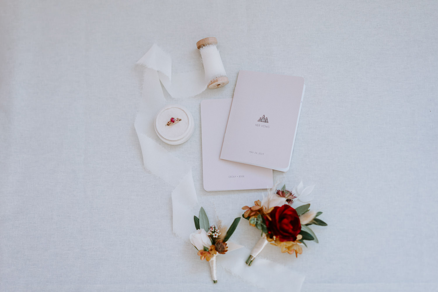 wedding details, ring, vow books, boutonniere