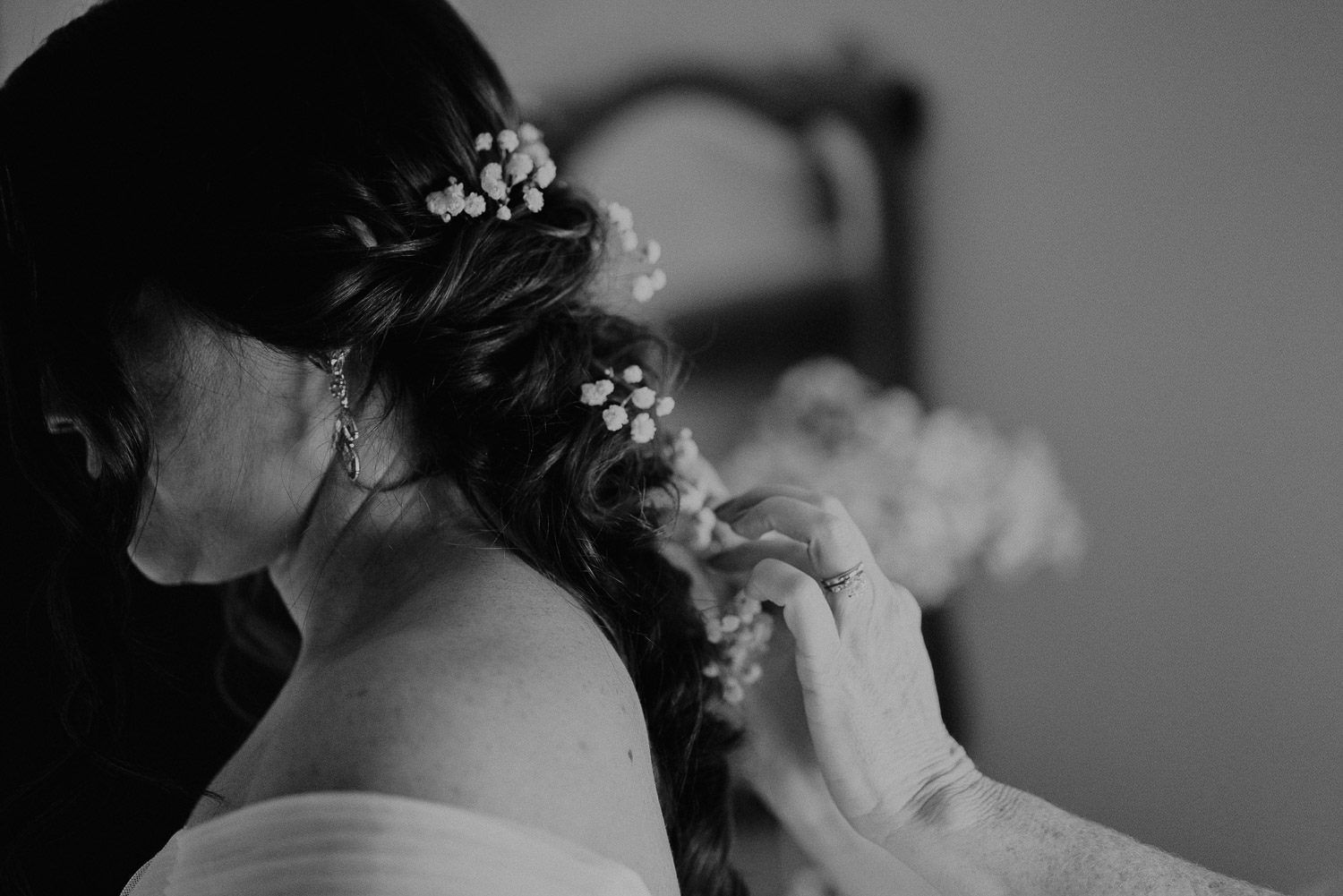Bride gets help with her hair.