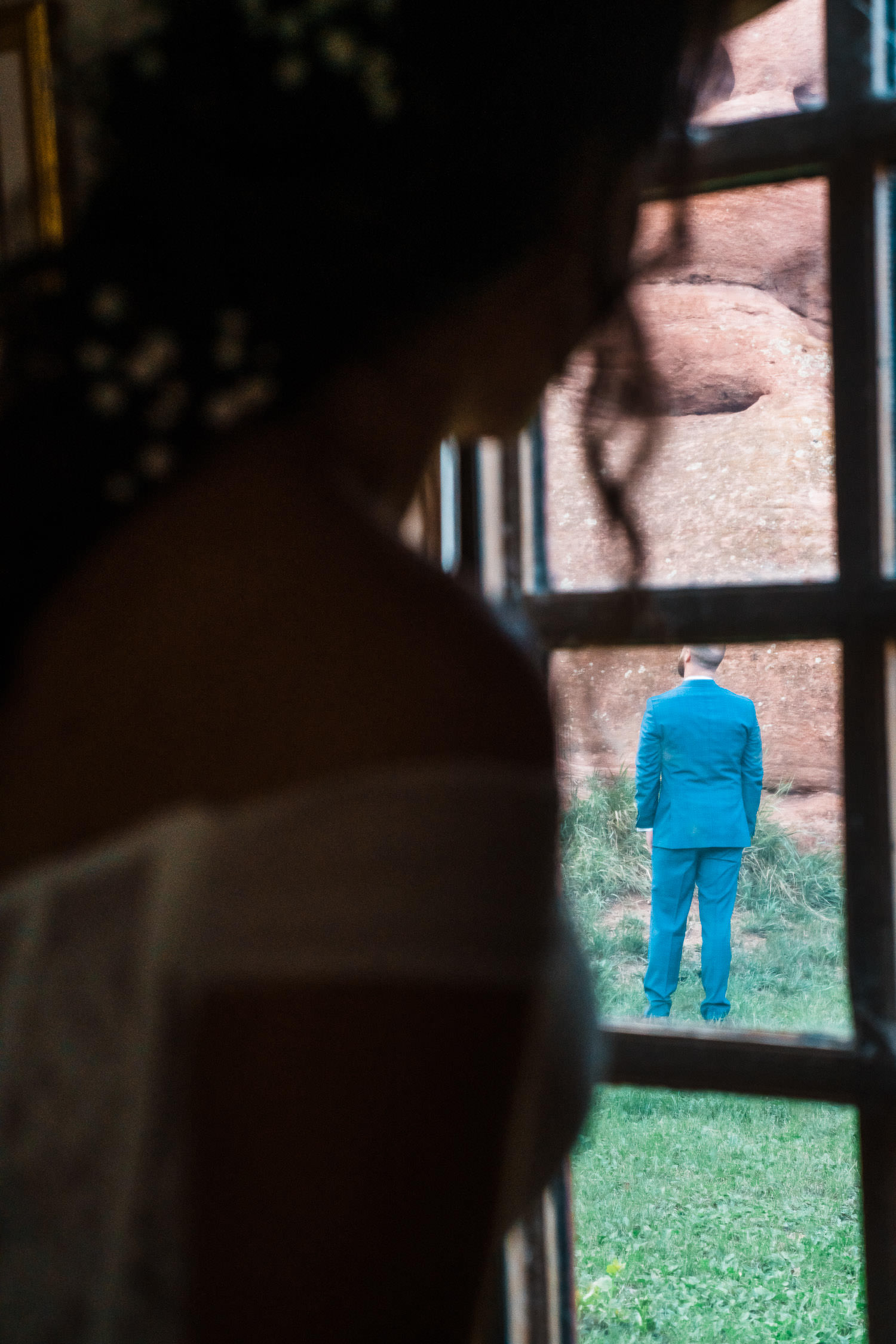 Bride looks out at her groom before their first look.