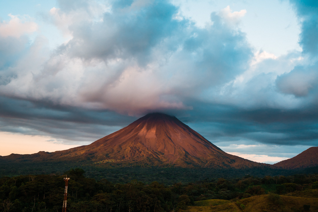 Costa Rica volcanTips for planning your dream elopement | Run Wild With Me 11o stands strong in the sky.